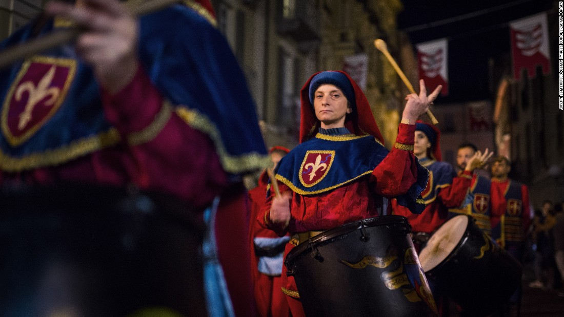 Performers in medieval costume parade through the streets at the Palio di Asti, an Italian festival dating back to the 13th century that culminates in a bareback horse race.