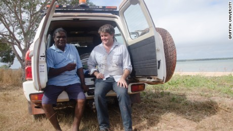 Researcher Michael Westaway taking saliva samples with Elder Thomas Wales.