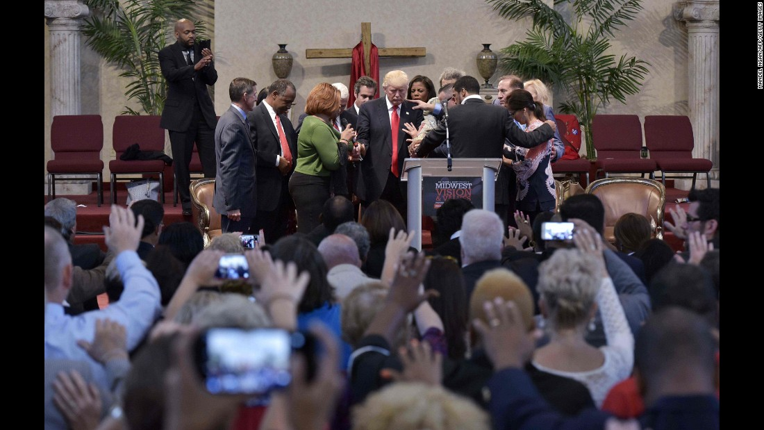 People pray with Donald Trump, the Republican Party's presidential nominee, during the Midwest Vision and Values Pastors and Leadership Conference. The event was held in Cleveland Heights, Ohio, on Wednesday, September 21.
