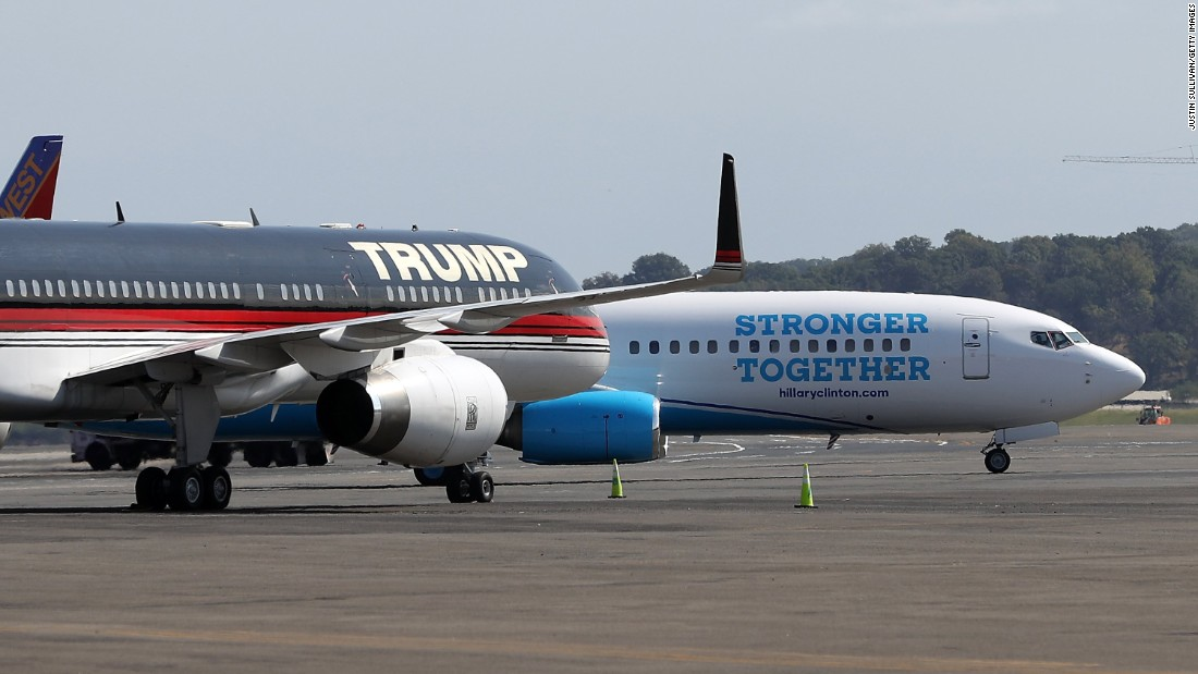 The campaign planes of presidential candidates Donald Trump and Hillary Clinton sit on the tarmac Friday, September 16, at Reagan National Airport near Washington.