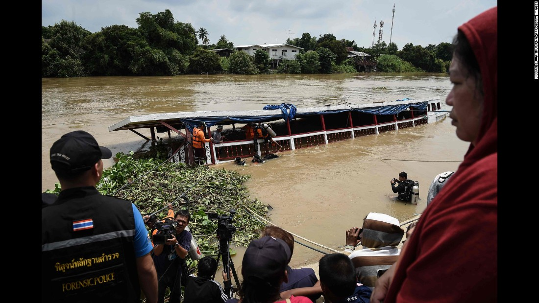 "Rescue workers look for missing people the day after <a href=""http://www.cnn.com/2016/09/18/asia/thailand-boat-capsizes/"" target=""_blank"">a tourist boat capsized</a> in central Thailand on Sunday, September 18. More than two dozen people were killed."