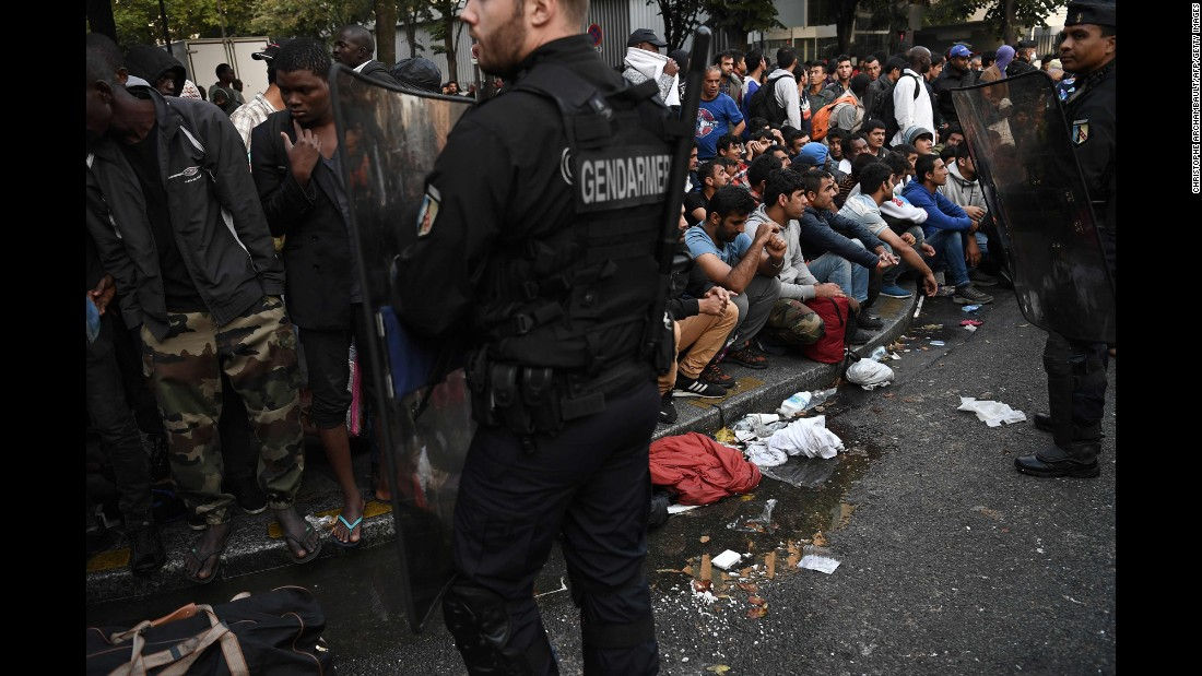 French gendarmes secure an area in Paris where a makeshift migrant camp was being dismantled on Friday, September 16. The migrants were moved to other shelters.