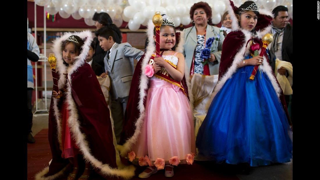 "From left, Vanesa Huanca, Shanik Vera and Claudia Martinez wear capes after being crowned ""Spring Queens"" by their teachers in El Alto, Bolivia, on Wednesday, September 21."