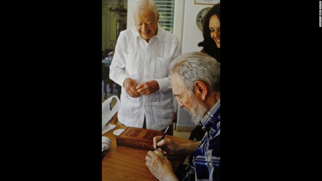 Fidel Castro signs a baseball for former US President Jimmy Carter in a photograph featured in Alex Castro's book on his father.