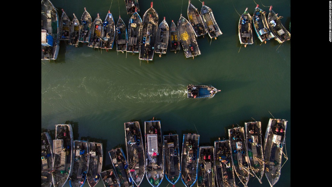A fishing boat heads out to sea in the Chinese province of Lianoning on Monday, September 19.