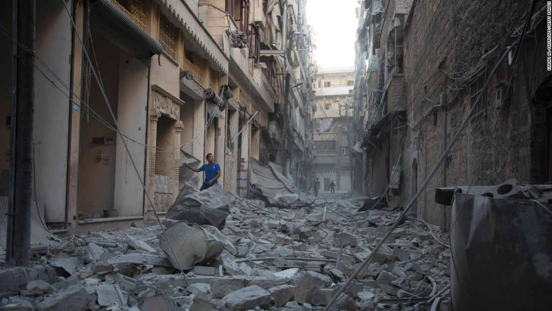 A man stands in the rubble of destroyed buildings following an airstrike in Aleppo, Syria, on Sunday, September 18.
