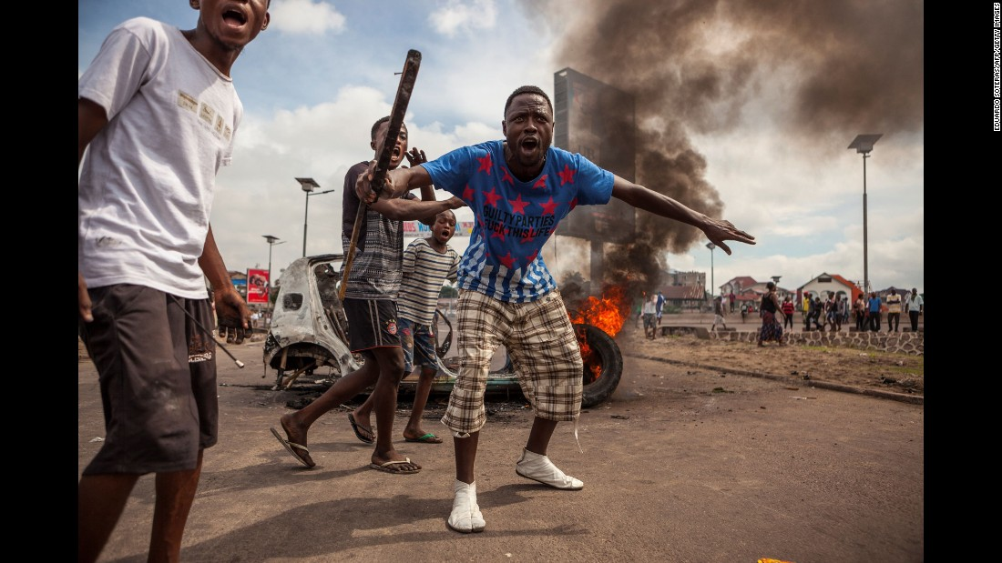 "Demonstrators gather in front of a burning car during an opposition rally in Kinshasa, Democratic Republic of Congo, on Monday, September 19. The government<a href=""http://www.cnn.com/2016/09/19/africa/congo-unrest-protests/"" target=""_blank""> is urging calm</a> following protests that led to at least 17 deaths. The protesters are upset with the national electoral commission's failure to announce a timetable for the presidential election, which is due to take place in November."