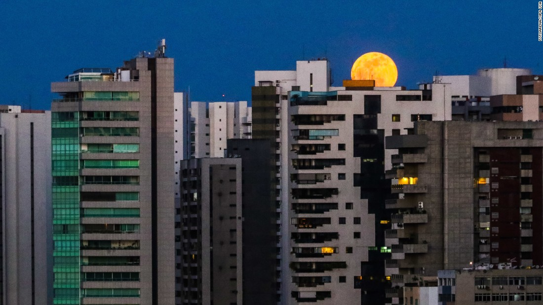 "A <a href=""http://www.cnn.com/2016/09/17/world/harvest-moon-2016-irpt/"" target=""_blank"">harvest moon</a> is partially hidden by buildings in Fortaleza, Brazil, on Friday, September 16. <a href=""http://www.cnn.com/2016/09/15/world/gallery/week-in-photos-0916/index.html"" target=""_blank"">See last week in 35 photos</a>"