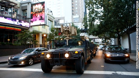 CHARLOTTE, NC - SEPTEMBER 22:  North Carolina Nation Guard troops pull into Uptown Charlotte on September 22, 2016 in Charlotte, North Carolina.  As activists continue to protest the death of Keith Scott, police prepare for another round of possible unrest. Scott, 43,  was shot and killed by police officers at an apartment complex near UNC Charlotte. (Photo by Brian Blanco/Getty Images)