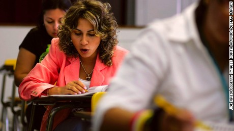 MIAMI - JUNE 16:  Ivonne Ramos, originally from Guatemala, practices reading out loud a passage from her English book in class at the English Center June 16, 2006 in Miami, Florida. The school holds adult education classes that include English language classes for people who have immigrated to the United States. U.S. President George W. Bush recently said, ?Part of the greatness of America is that we've been able to help assimilate people into our society... And part of that assimilation process is English. I believe this: If you learn English, and you're a hard workera dream, you hav, and you have a dream, you have the capacity from going from picking crops to owning the store, or from sweeping office floors to being an office manager.?  (Photo by Joe Raedle/Getty Images)