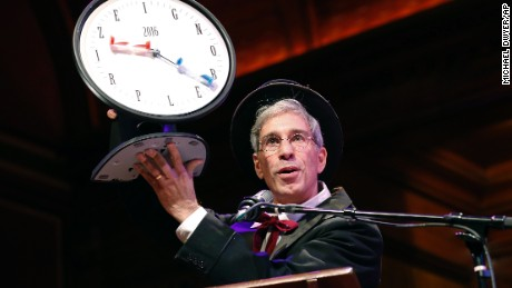 Master of Ceremonies Marc Abrahams holds up the 2016 Ig Nobel award during ceremonies at Harvard University in Cambridge, Mass., Thursday, Sept. 22, 2016.