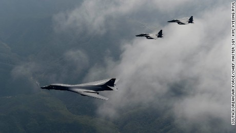 A U.S. Air Force B-1B Lancer is flanked by two F-15K Slam Eagles during a flight over South Korea, September 21, 2016.