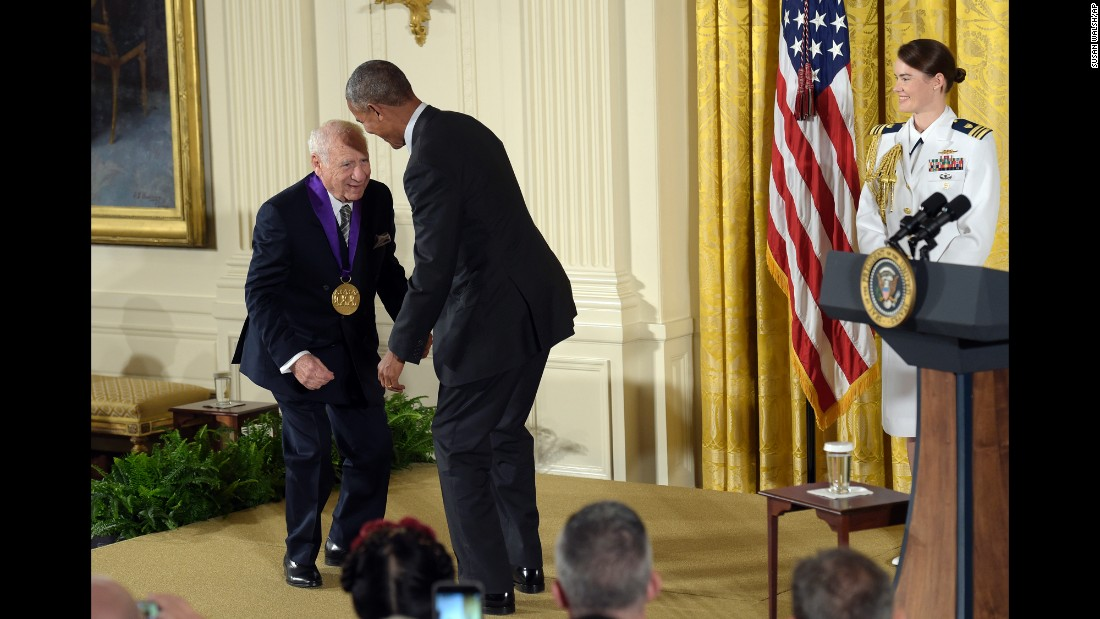 President Barack Obama jokes with entertainer Mel Brooks after Brooks was presented with a National Medal of Arts on Thursday, September 22. After receiving his medal, Brooks pretended to pull down the President's pants.