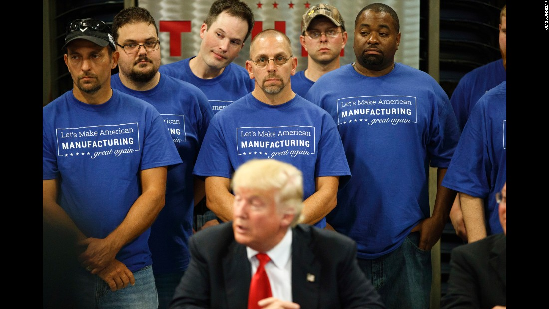 Workers at Staub Manufacturing listen as Republican presidential nominee Donald Trump speaks in Dayton, Ohio, on Wednesday, September 21.