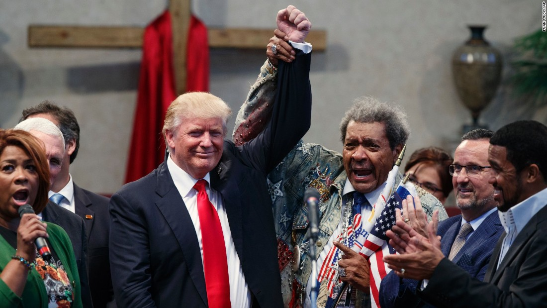 Boxing promoter Don King holds up the hand of Republican presidential nominee Donald Trump during Trump's visit to the Pastors Leadership Conference in Cleveland on Wednesday, September 21.