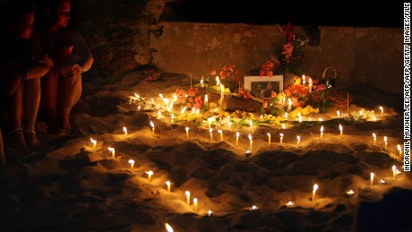 People hold an inpromptu tribute on Anjuna beach on the first anniversary of the girl's death in 2009.