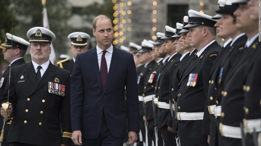 William inspects an honor guard during the welcome ceremony on September 24.