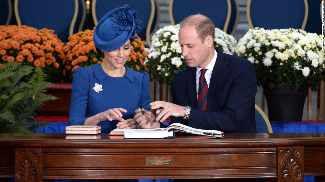 The royals sign the Canadian government's Golden Book at the Legislative Assembly in Victoria on September 24.