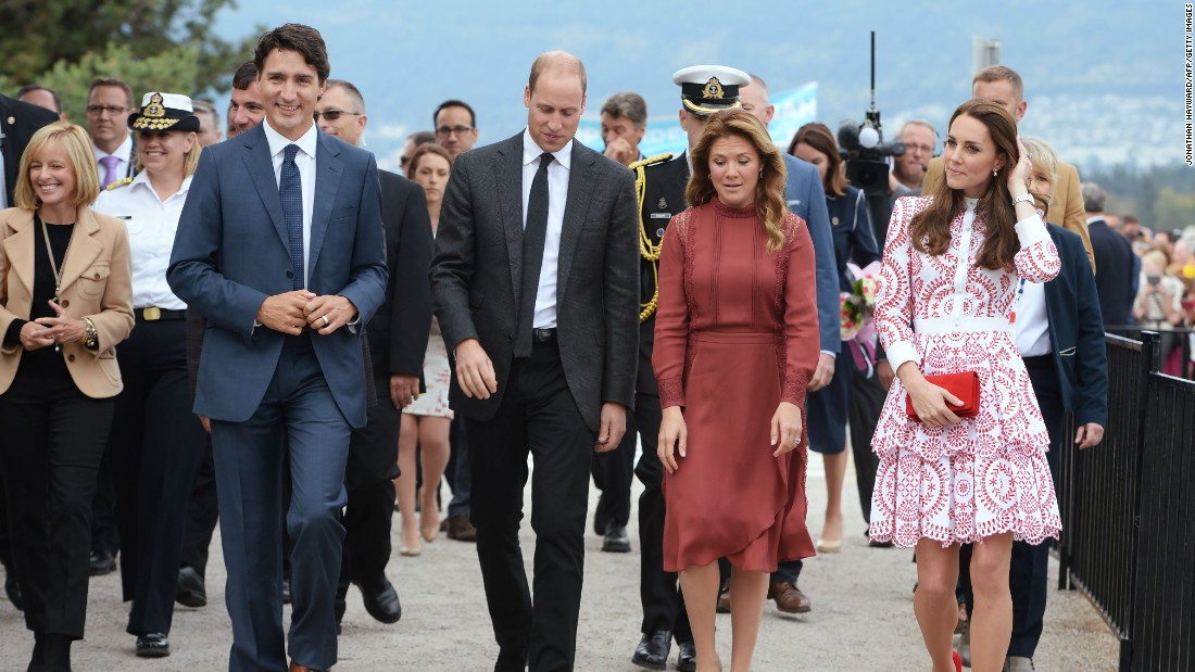 Canadian Prime Minister Justin Trudeau,  left, and his wife Sophie Gregoire Trudeau, second from right, accompany the royals on a tour of the Kitsilano Coast Guard Base in Vancouver, British Columbia, on September 25.