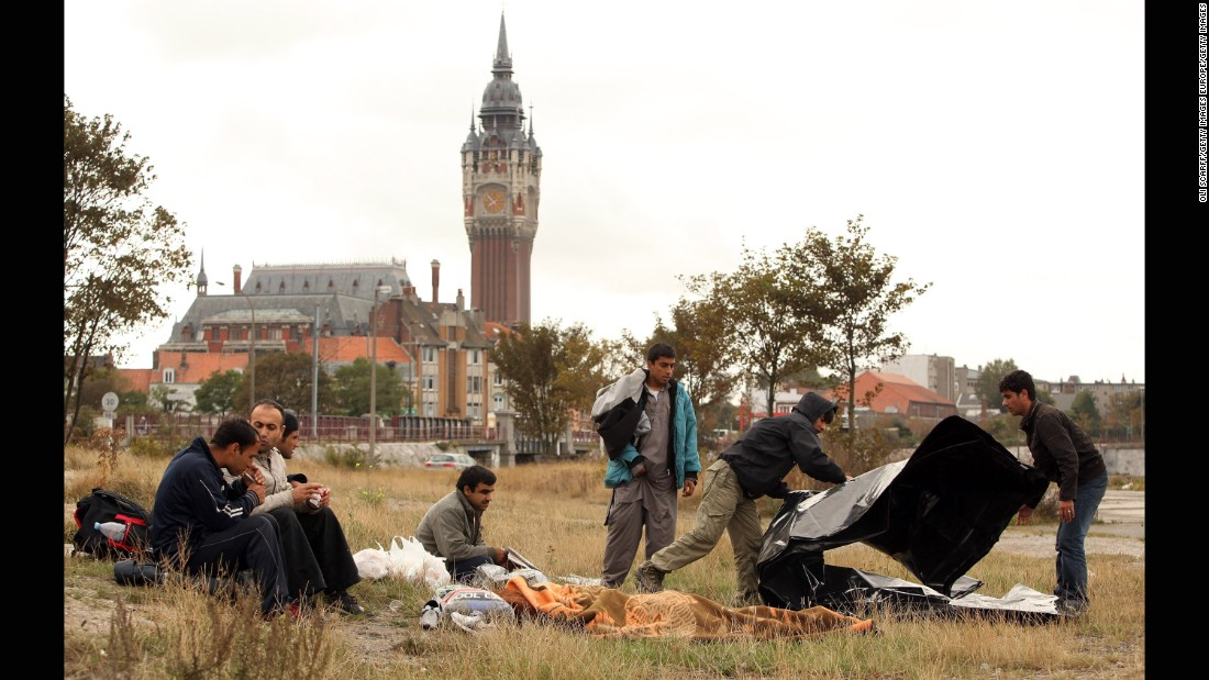"Displaced from ""The Jungle"" camp, Afghan migrants congregate in Calais' harbor in September 2009."