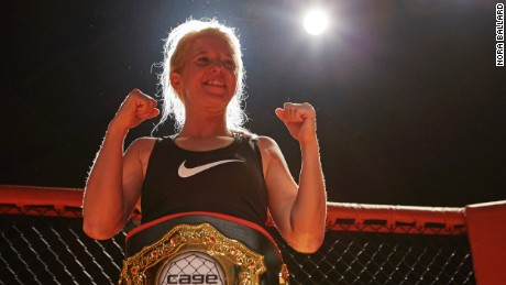 Malinda Diffee, MMA fighter, strikes a pose in the cage.