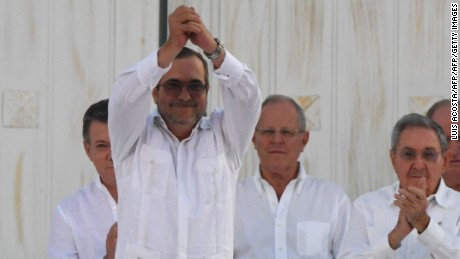 The head of the FARC, Timoleon Jimenez, aka Timochenko, gestures as he signs the historic peace agreement with the Colombian government on September 26, 2016.
