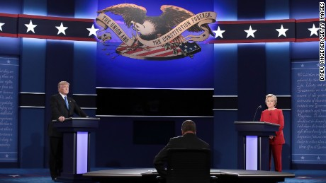 HEMPSTEAD, NY - SEPTEMBER 26:  Republican presidential nominee Donald Trump debates Democratic presidential nominee Hillary Clinton as Moderator Lester Holt (C) looks on during the Presidential Debate at Hofstra University on September 26, 2016 in Hempstead, New York.  The first of four debates for the 2016 Election, three Presidential and one Vice Presidential, is moderated by NBC's Lester Holt.  (Photo by Drew Angerer/Getty Images)
