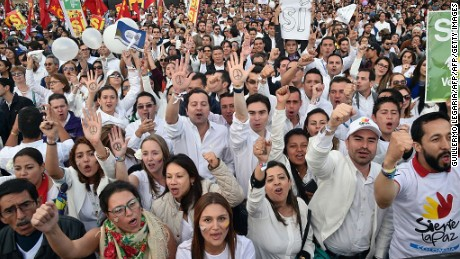 Colombians gather in the Bogota's Bolivar main square on September 26, 2016, to celebrate the historic peace agreement between the Colombian government and the Revolutionary Armed Forces of Colombias (FARC). 