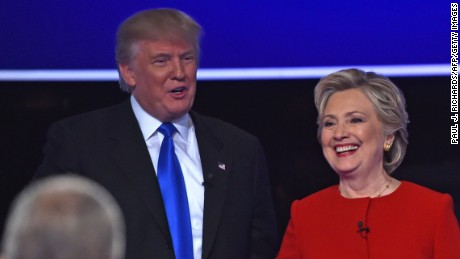 Hillary Clinton and Donald Trump shake hands following the first presidential debate moderated by NBC host Lester Holt(bottom L) at Hofstra University in Hempstead, New York on September 26, 2016.