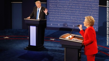 HEMPSTEAD, NY - SEPTEMBER 26:  Republican presidential nominee Donald Trump (L) speaks as Democratic presidential nominee Hillary Clinton listens during the Presidential Debate at Hofstra University on September 26, 2016 in Hempstead, New York.  The first of four debates for the 2016 Election, three Presidential and one Vice Presidential, is moderated by NBC's Lester Holt.  (Photo by Pool/Getty Images)