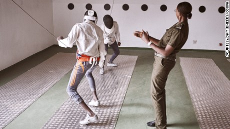 Prison guard Fatoumata Sy referees a fencing match between minors.
