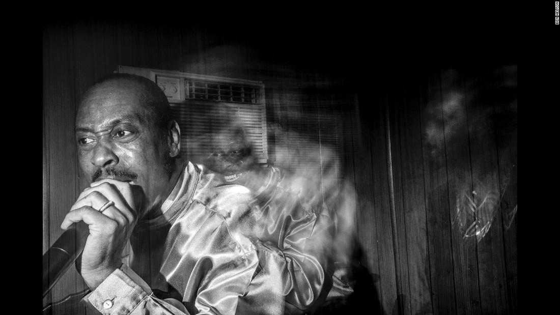 A long-exposure photograph of one of the church members singing.