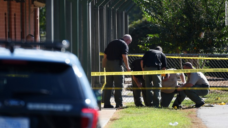 Members of law enforcement investigate an area at Townville Elementary School on Wednesday, Sept. 28, 2016, in Townville, S.C.   A teenager opened fire at the South Carolina elementary school Wednesday, wounding two students and a teacher before the suspect was taken into custody, authorities said.  (AP Photo/Rainier Ehrhardt)