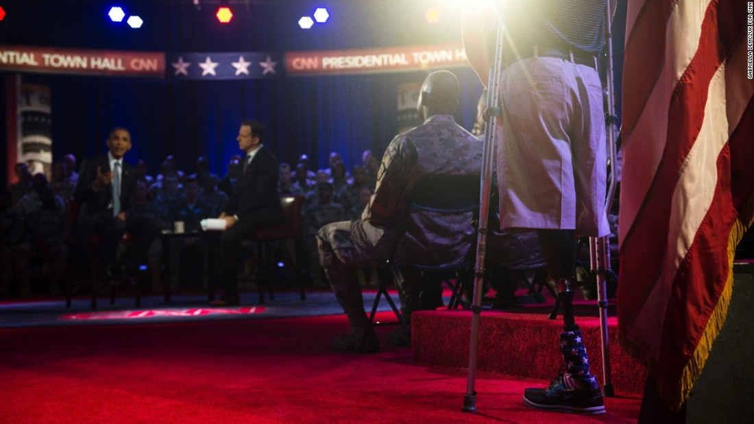 "U.S. President Barack Obama answers a question from Marine Cpl. Brandon Rumbaugh during <a href=""http://www.cnn.com/2016/09/28/politics/gallery/obama-town-hall/index.html"" target=""_blank"">a town-hall event</a> in Fort Lee, Virginia, on Wednesday, September 28. Rumbaugh lost both of his legs during his second deployment to Afghanistan. He was one of <a href=""http://www.cnn.com/2016/09/28/politics/highlights-questions-obama-presidential-town-hall-military/"" target=""_blank"">several service members who asked questions</a> during the forum, which focused on issues related to the military."