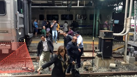 Passengers rush to safety after a NJ Transit train crashed in to the platform at the Hoboken Terminal September 29, 2016 in Hoboken, New Jersey.