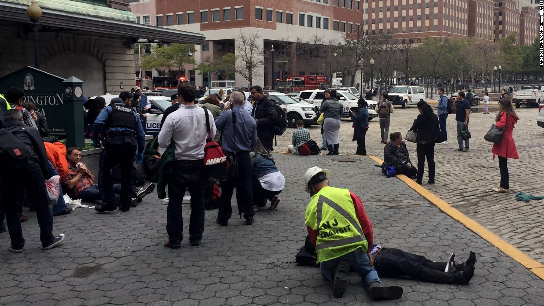 People are treated for their injuries outside the Hoboken  station.