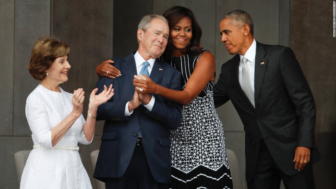 "First lady Michelle Obama hugs former U.S. President George W. Bush during the dedication ceremony of <a href=""http://www.cnn.com/2016/09/23/politics/smithsonian-african-american-museum-obama/"" target=""_blank"">the new Smithsonian museum</a> devoted to African-American history. The museum opened in Washington on Saturday, September 24. <a href=""http://www.cnn.com/2016/09/24/politics/michelle-obama-george-w-bush-friendship/"" target=""_blank"">Read more: The friendship of Michelle Obama and George W. Bush</a>"