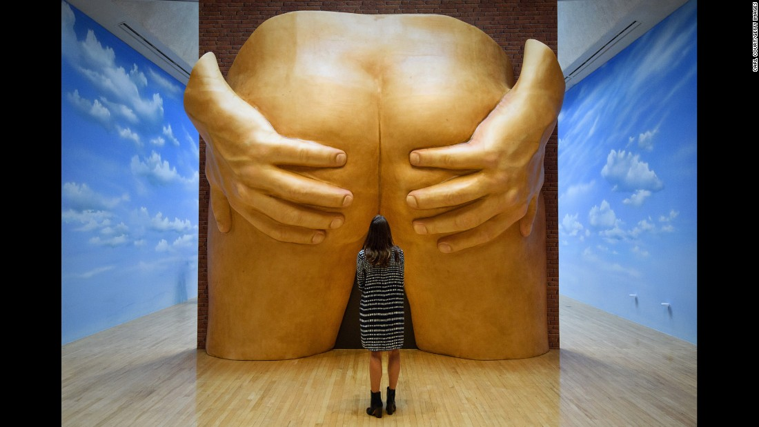 "<strong>September 26: </strong>A staff member at the Tate Britain art museum poses next to Anthea Hamilton's ""Project for a Door"" during a press preview in London. <a href=""http://www.cnn.com/2016/09/28/arts/turner-prize-2016/index.html"" target=""_blank"">A deeper look into the art world's most controversial award: The Turner Prize</a>"