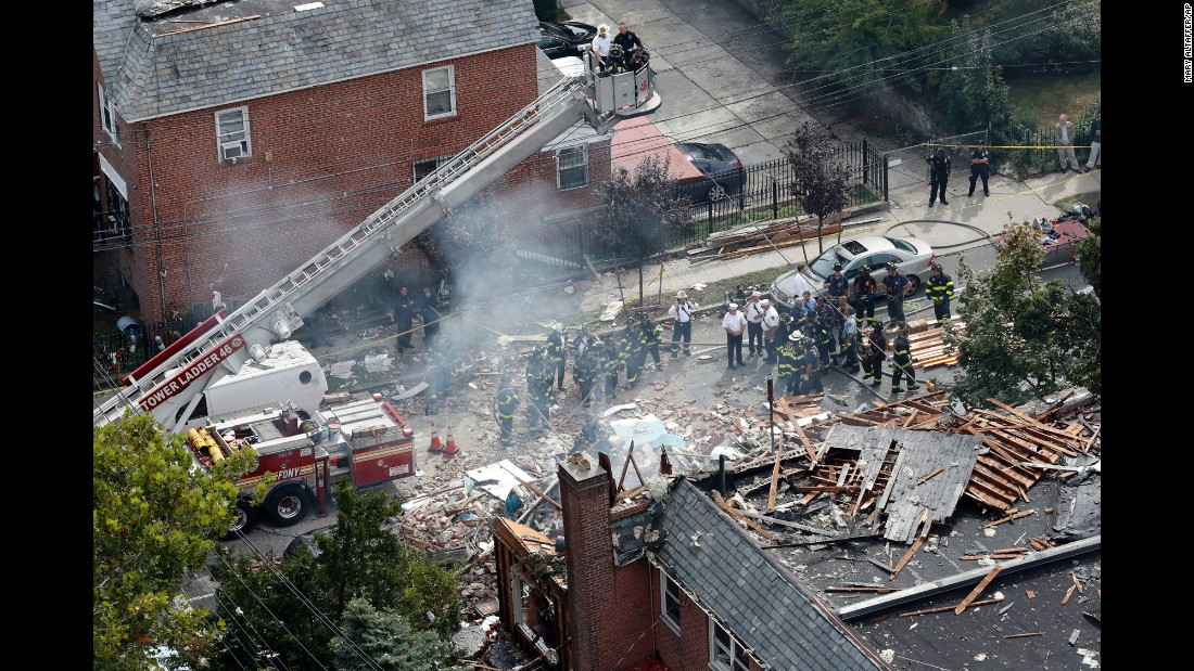"Emergency personnel work at the scene of a house explosion in New York on Tuesday, September 27. Fire Battalion Chief Michael Fahy <a href=""http://www.cnn.com/2016/09/27/us/new-york-firefighter-death/"" target=""_blank"">was killed in the explosion</a> as he directed the response to a possible gas leak. The cause of the explosion is under investigation."
