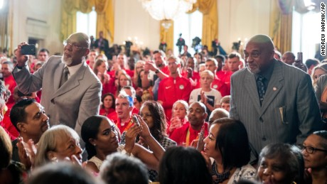 John Carlos, left, and Tommie Smith stand as they are recognized by President Barack Obama during a White House ceremony Thursday.