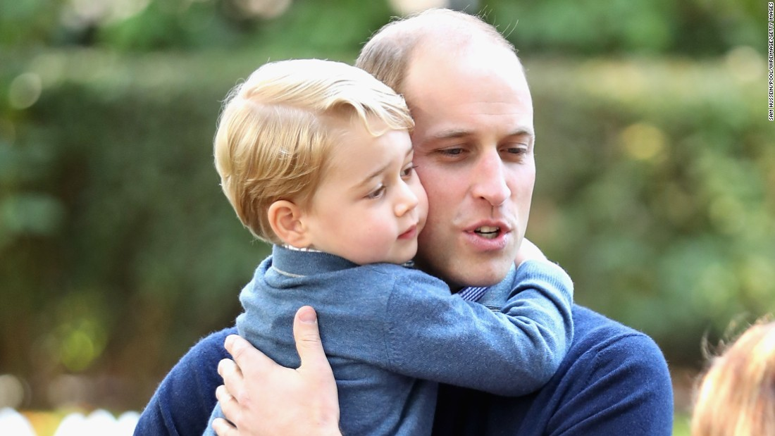 Prince William holds Prince George on September 29.