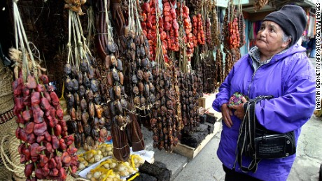 "An old woman looks for smoked seafood at ""Angelmo""  typical market in Puerto Montt,1000 km south of Santiago, 26th October 2007. Products like mussels and clams are typical seafoofd from Chile's southern coast. AFP PHOTO MARTIN BERNETTI (Photo credit should read MARTIN BERNETTI/AFP/Getty Images)"