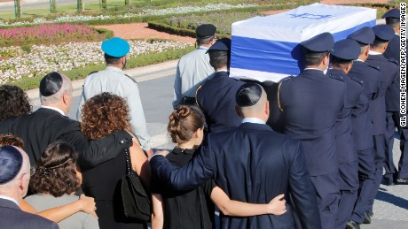 Family members walk behind the coffin of former Israeli premier Shimon Peres carried by members of the parliamentary guards at the Knesset, Israel's Parliament, at the start of his funeral in Jerusalem on September 30, 2016.  Security forces were on high alert for the funeral beginning at 9:00 am (0600 GMT) at Jerusalem's Mount Herzl national cemetery, with roads closed and thousands of officers deployed. / AFP / GIL COHEN-MAGEN        (Photo credit should read GIL COHEN-MAGEN/AFP/Getty Images)