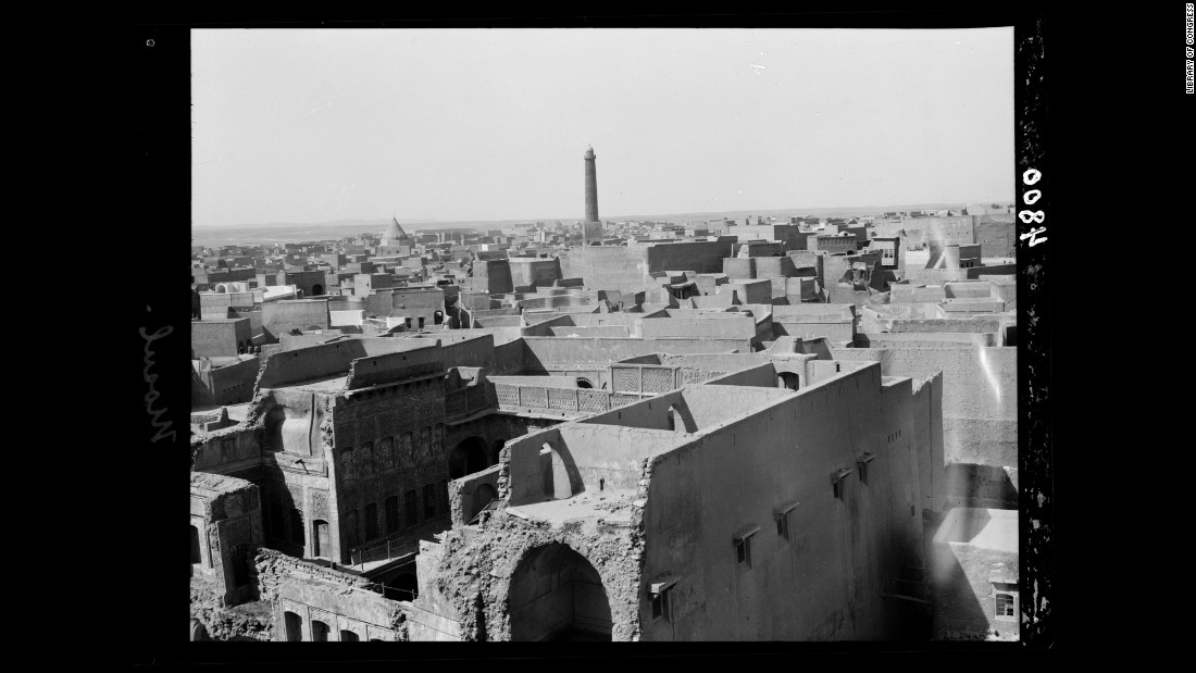 The famous leaning minaret of Mosul's 12th-century Great Mosque of al-Nuri towers in the background of this photo taken in the 1930s.