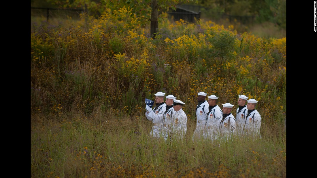"A U.S. Navy honor guard walks with a flag to the Wall of Names at the Flight 93 National Memorial in Shanksville, Pennsylvania, on Sunday, September 11. <a href=""http://www.cnn.com/2016/09/11/us/gallery/911-15th-anniversary/index.html"" target=""_blank"">See more memorials from the 15th anniversary of the 9/11 attacks</a>"