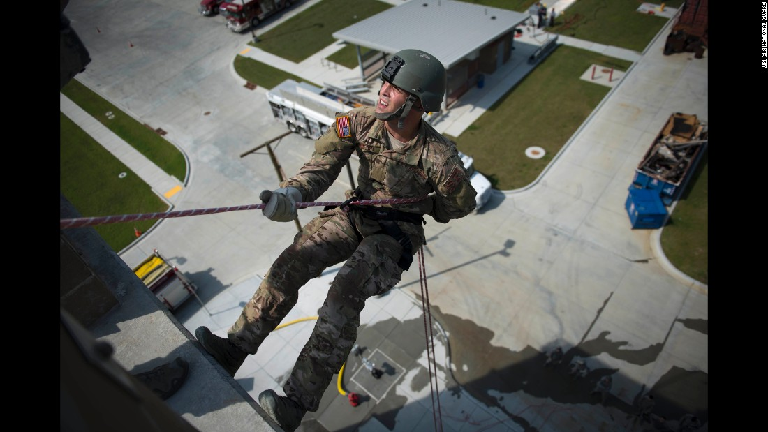 A member of the Oklahoma Air National Guard rappels down a building at a training center in Tulsa, Oklahoma, on Thursday, September 15.
