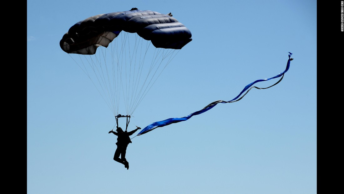 A member of the U.S. Air Force Wings of Blue parachute team descends toward Texas' Sheppard Air Force Base during an air show on Saturday, September 17.