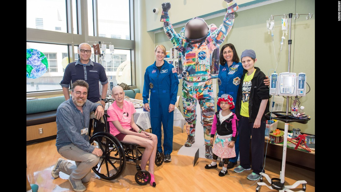 Ian Cion, the Arts in Medicine artist-in-residence at MD Anderson hospitals, (far left), coordinated with Rubins and retired astronaut Nicole Stott (second from right), to bring the Space Suit Project to life and allow childhood cancer patients to create the suits.