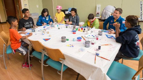 """Paint with the Astronauts"" day with Reid Wiseman and Nicole Stott."