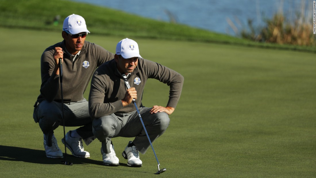 Rafa Cabrera Bello and Sergio Garcia of Europe line up a putt on the 7th green.